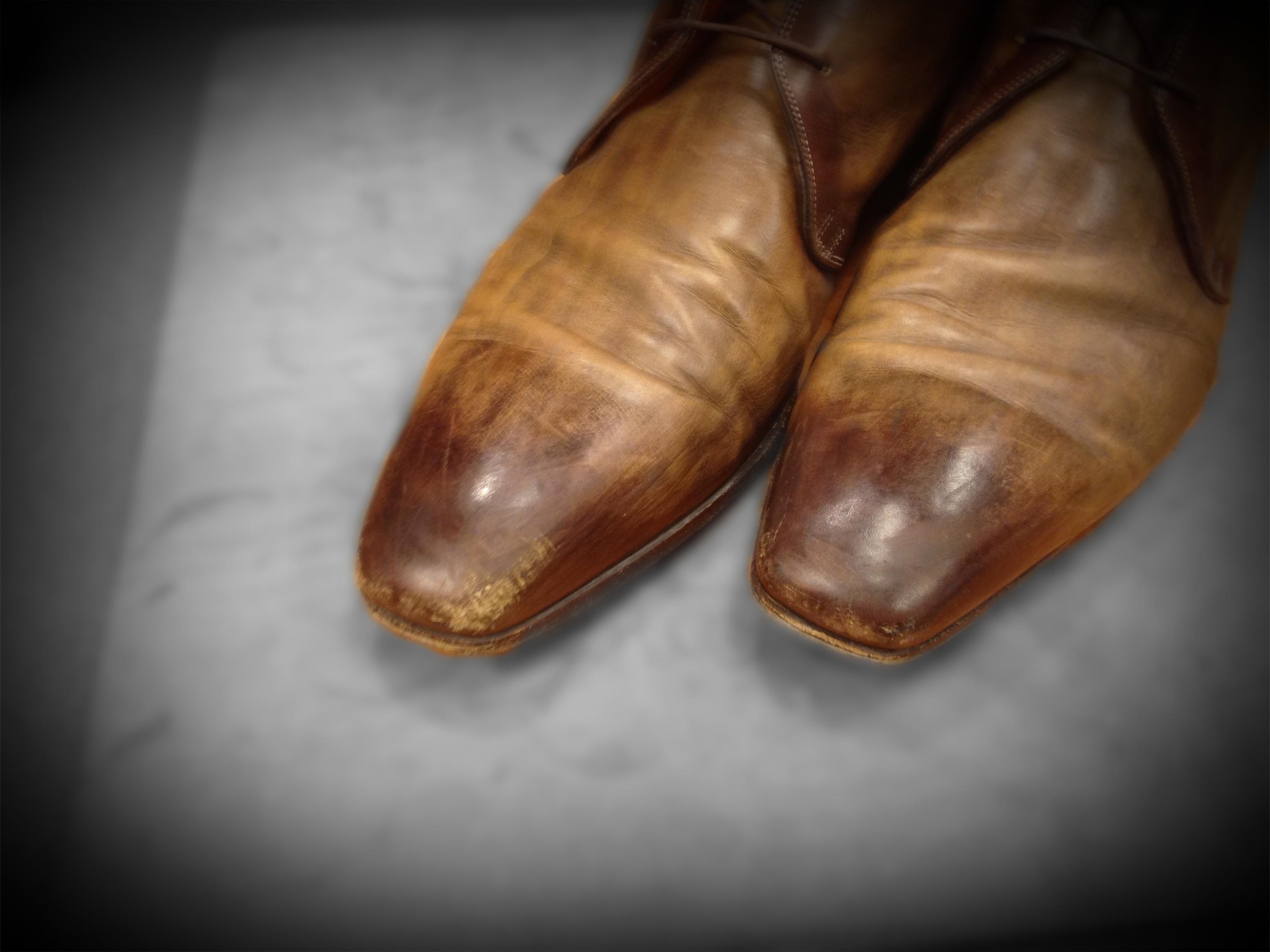 Beschadiging leren schoen